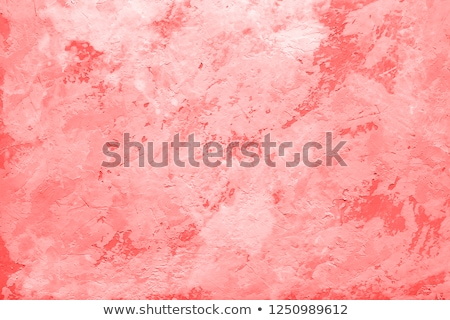 painted stone wall texture in living coral color Stock photo © dolgachov