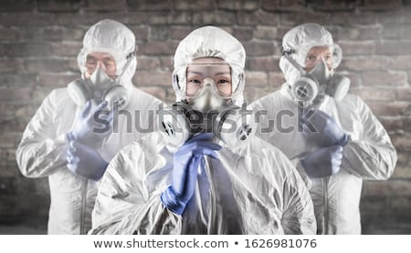 Chinese Woman and Team Behind In Hazmat Suites, Gas Masks and Go Stock photo © feverpitch