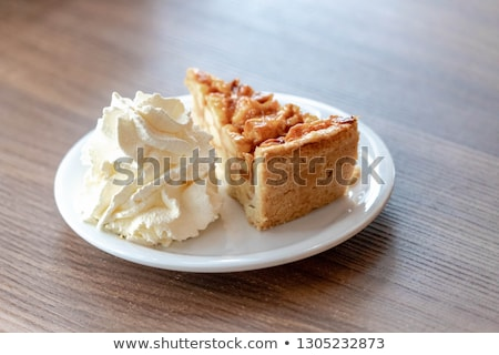 Slice of homemade dutch apple pie with whipped cream Stock photo © Melnyk