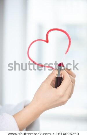 Mano femminile rossetto colore Foto d'archivio © pressmaster