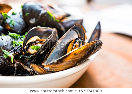 seafood mussels with lemon, parsley and garlic Stock photo © joannawnuk