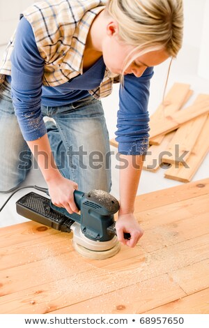 Handywoman with a sander Stock photo © photography33