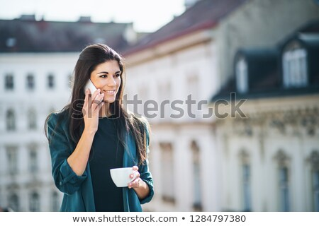 Businesswoman making phone call outside office Stock photo © photography33