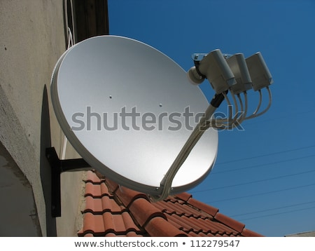 Parabolic satellite dish receiver over blue sky Stock photo © lunamarina