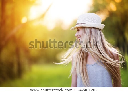 Beautiful young woman walking on the summer park Stock photo © Andersonrise