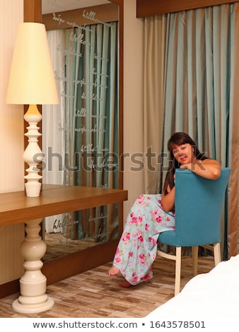 brunette in long dress near a hotel Stock photo © ssuaphoto