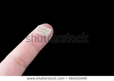 simcard in my fingers Stock photo © jonnysek