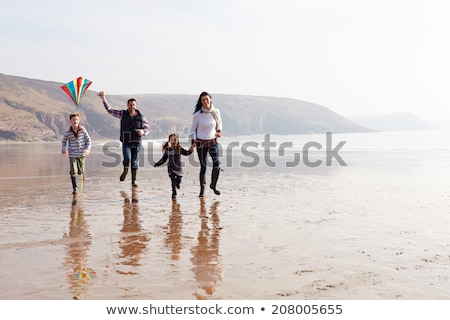 family having fun on winter beach stock photo © monkey_business