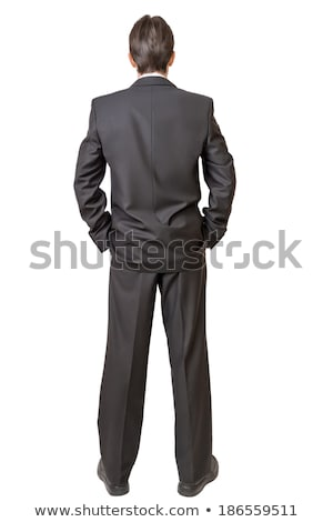 Caucasian businessman standing with arms at sides rear view Stock photo © dgilder