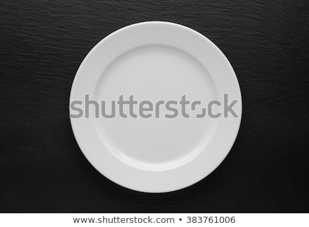 Top view of white plate with spoon and fork Stock photo © punsayaporn