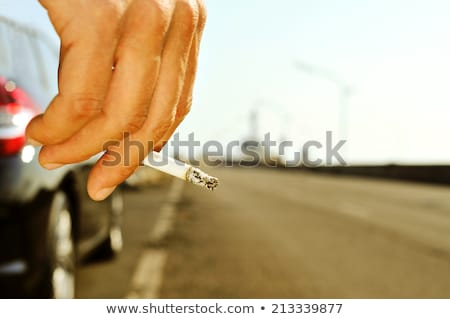 man smoking on a no traffic road Stock photo © nito