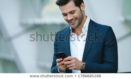 portrait of handsome confident young businessman stock photo © hasloo