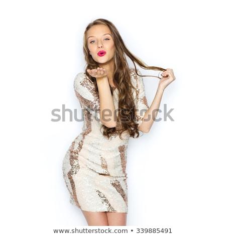 mosolyog · fiatal · nő · tinilány · küldés · ütés · csók - stock fotó © dolgachov