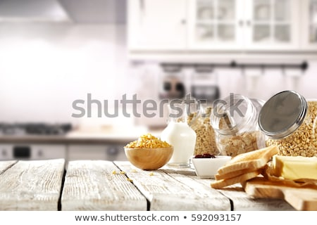 Breakfast on table with milk and cereal Stock photo © bluering