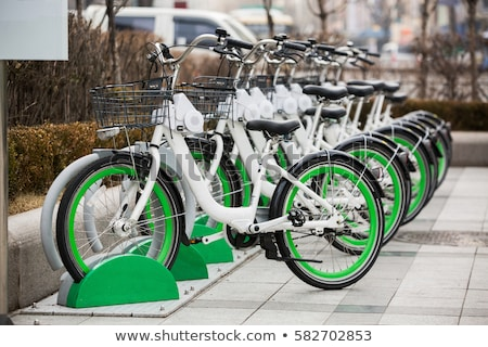 Row of rental bikes Stock photo © zurijeta