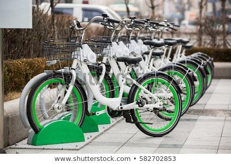 Csetepaté bérlet biciklik kék város bicikli Stock fotó © zurijeta