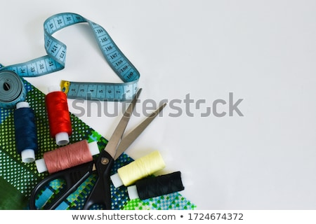 flat lay of sewing tool and accessories on white wooden backgrou stock photo © yatsenko