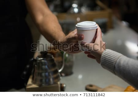 Mid section of waiter serving coffee to customer at counter Stock photo © wavebreak_media