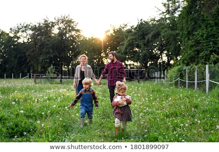 retrato · de · família · menina · homem · jardim · mãe · pai - foto stock © is2