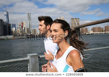 Woman running by the hudson river Stock photo © IS2
