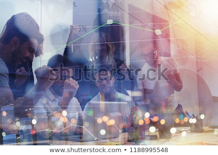 Working group of businessmen exults for having achieved the goal. concept of teamwork and business p Stock photo © alphaspirit