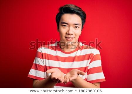 Afbeelding knappe man gestreept tshirt glimlachend Stockfoto © deandrobot