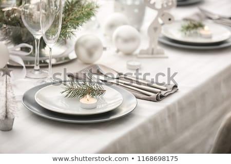 christmas table setting with decor and fir tree stock photo © karandaev