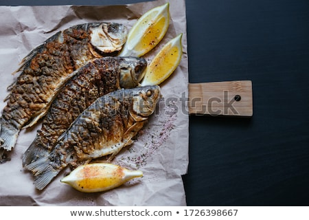 Grilled carp with lemon slices on a wooden board Stock photo © ruslanshramko