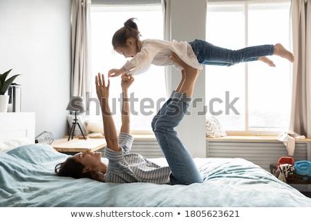 小さな 母親 午前 ヨガ ベッド 家族 ストックフォト © Lopolo