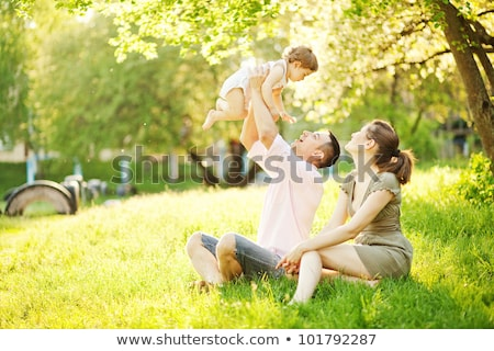 Happy young family spending time outdoor on a summer day Stock photo © dashapetrenko