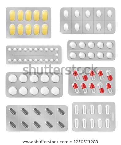 Gyógyszer tabletták ezüst hólyag csomag fehér Stock fotó © DenisMArt
