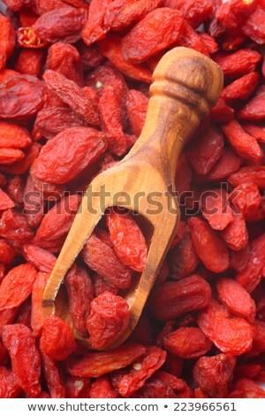 Goji berries in wooden scoop, one of the superfoods Stock photo © Melnyk