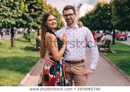 Kettő párok férfiak pólók nadrág nők Stock fotó © robuart
