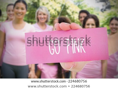 Kéz tart kártya rózsaszín mellrák tudatosság Stock fotó © wavebreak_media