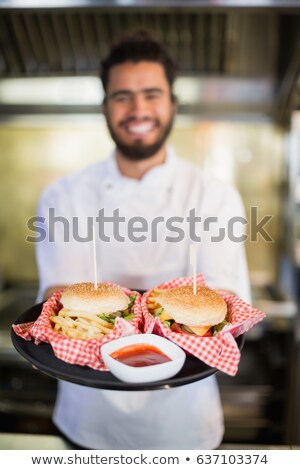 Feliz masculino chefs placas preparado Foto stock © wavebreak_media