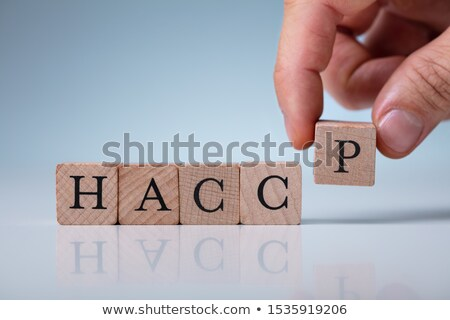 Hand Arranging HACCP Letters Stock photo © AndreyPopov