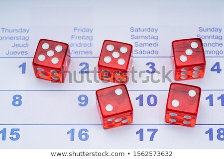 Transparent Red Dice With White Dots On Calendar Dates Stock photo © AndreyPopov