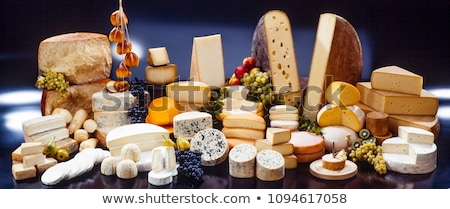 Selection of various cheese on the board on wooden background. Blue Stilton, Red Leicester and Brie  Stock photo © DenisMArt