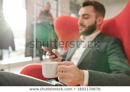 Main jeunes affaires tasse thé détente Photo stock © pressmaster