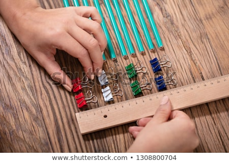 Person Arranging The Clips With Scale Stock photo © AndreyPopov