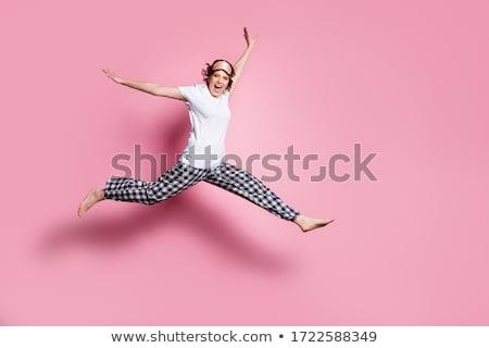 Feliz mulher saltando alto diversão pessoas Foto stock © dolgachov