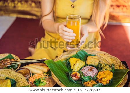 Jamu. Traditional medicine and herbal drink in Indonesia, most prevalent in Java. Made from natural  Stock photo © galitskaya