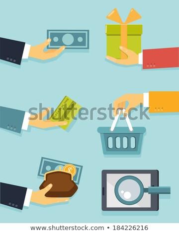 Mão moedas dinheiro compras on-line Foto stock © yupiramos