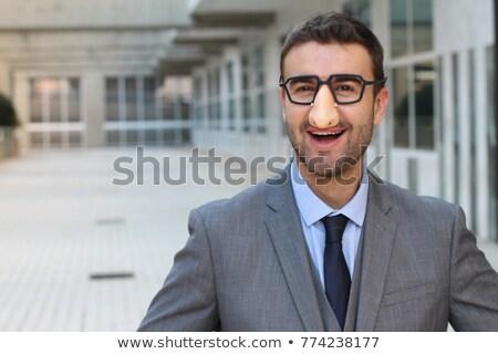 Smiling Businessman Wearing Groucho Marx Glasses Isolated on Whi Stock photo © Qingwa