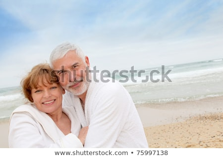 Man in bathrobe on the beach Stock photo © photography33