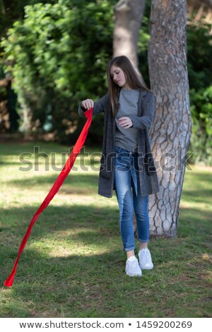 brunette woman playing with a red ribbon stock photo © rob_stark