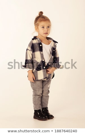 Naughty smiling girl in black shirt and jeans stock photo © pekour
