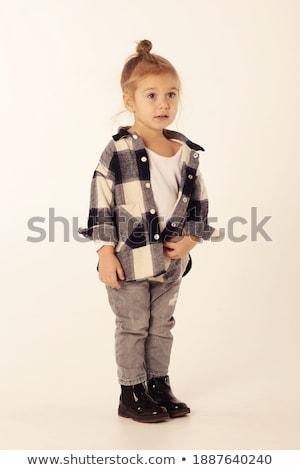 непослушный улыбаясь девушки черный рубашку джинсов Сток-фото © pekour