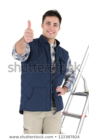 Tiles stood by his equipment giving thumbs-up Stock photo © photography33