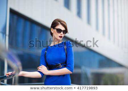Portrait of young modern female in blue fashion gown dress Stock photo © gromovataya